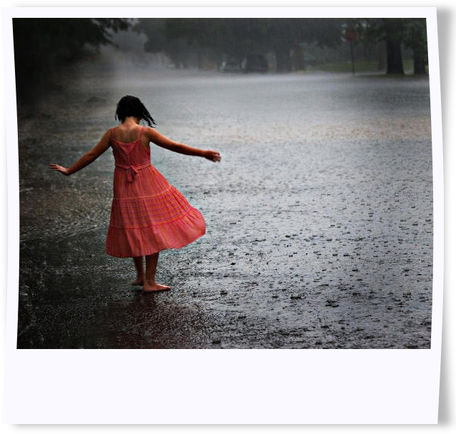 girl dances in rain
